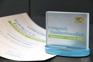 Urkunde und Pokal - SPANGLER GMBH